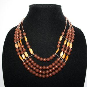 Layered brown gold and orange shell necklace adjus